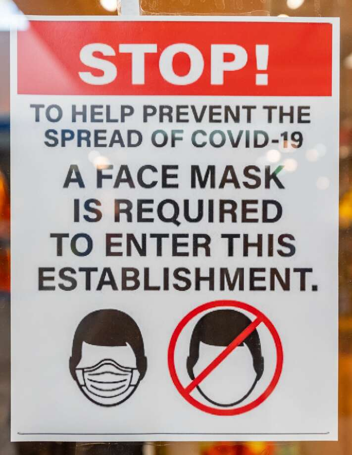 A sign on the door of a store in the Parkdale Mall about the requirement to wear a face mask in their store More people appear to be wearing masks when out in places of business. Photo made on June 28, 2020. Fran Ruchalski/The Enterprise Photo: Fran Ruchalski/The Enterprise / ? 2020 The Beaumont Enterprise