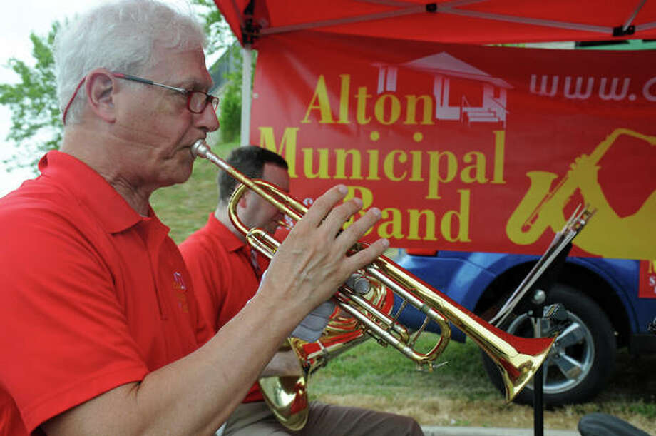 Dennis Meyer performs with a quintet of the Alton Municipal Band during Saturday's Alton Farmers' and Artisans' Market. The day kicked off the Alton Municipal Band's 130th consecutive season with a scaled-down, social-distanced performance for the weekly fresh fruits and vegetables crowd. Photo: David Blanchette|For The Telegraph