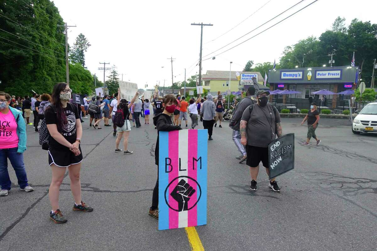 People block State St. as they gather at Bumpy's Polar Freeze for a protest on Sunday, June 28, 2020, in Schenectady, N.Y. The protest at the business was organized after what is alleged to be the owner's racist texts that had been leaked. (Paul Buckowski/Times Union)