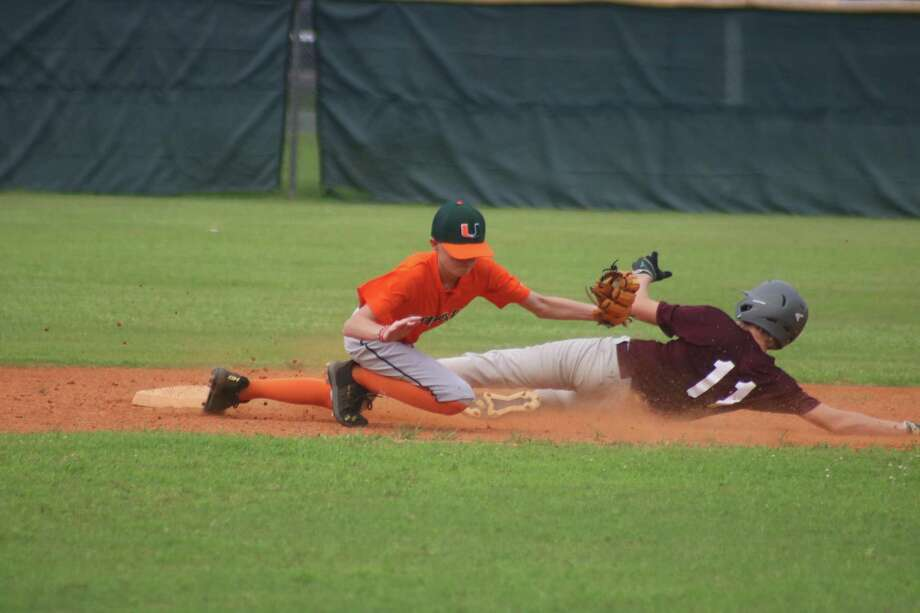 A&'s Zandec Kemberling slides into second base with the steal, while Miami's Hunter Houston gloves the late throw in Saturday's game. Photo: Robert Avery