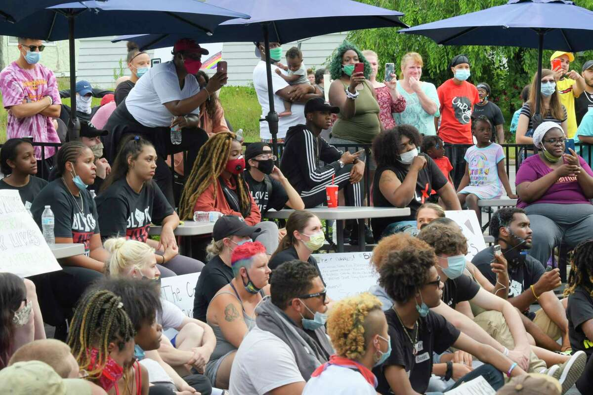 Protesters gather in front of Bumpy's Polar Freeze as they attempt to shut it down during a protest on Sunday, June 28, 2020, in Schenectady, N.Y. The protest at the business was organized after what is alleged to be the owner's racist texts that had been leaked. (Paul Buckowski/Times Union)