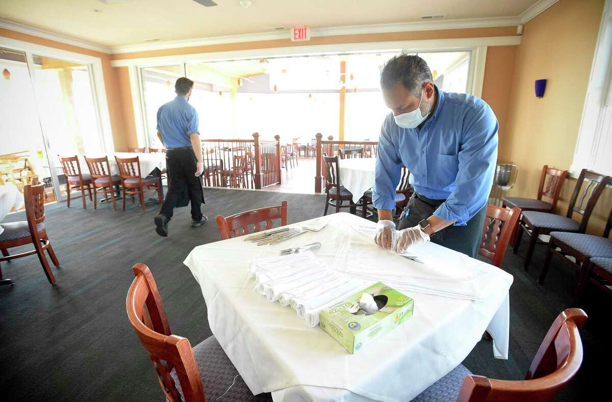 In a file photo, a Norwalk restaurant prepared for the Phase 2 reopening in June. Phase 3, which began last week, allowing restaurants to have indoor dining at 75-percent capacity, could be pulled back by local chief elected officials in towns that experience COVID resurgences, under an executive order from Gov. Ned Lamont that takes effect on Thursday.