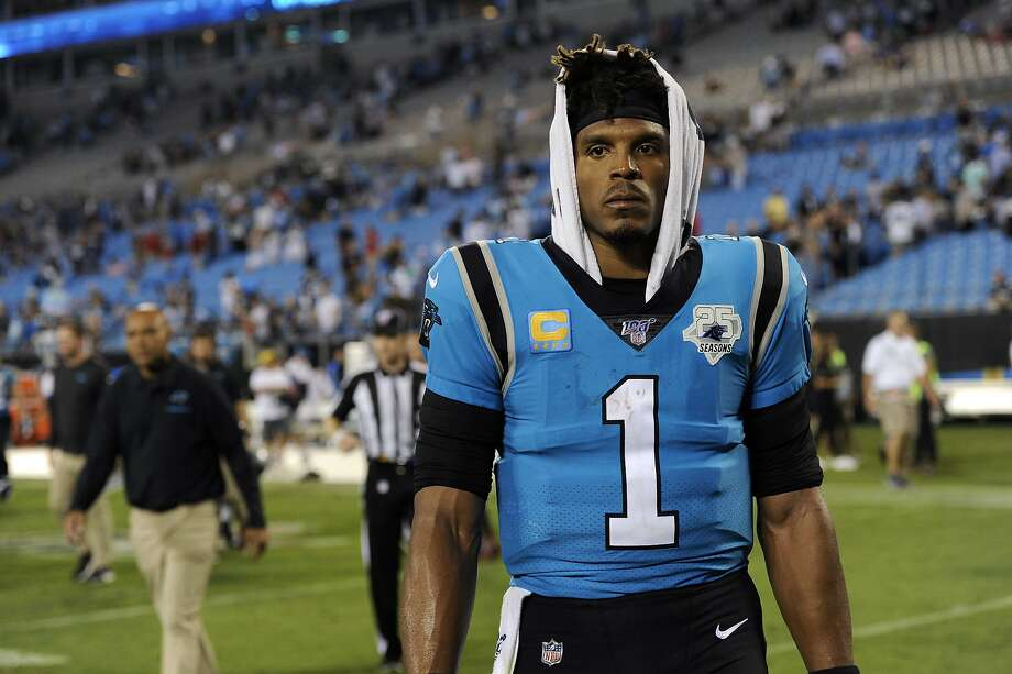 FILE - In this Sept. 13, 2019, file photo, Carolina Panthers quarterback Cam Newton (1) walks off the field following the Panthers 20-14 loss to the Tampa Bay Buccaneers in an NFL football game in Charlotte, N.C. (AP Photo/Mike McCarn, File) Photo: Mike McCarn, Associated Press