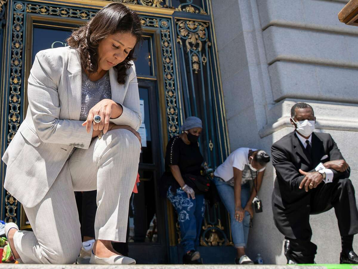 In honor of George Floyd, San Francisco Mayor London Breed takes a knee for eight minutes and 46 seconds with thousands of people during a rally at City Hall, Tuesday, June 9, 2020, in San Francisco, Calif. Black Lives Matter demonstrations in the Bay Area and protests in the nation continued following the death of George Floyd, who died restrained by Minneapolis police officers on Memorial Day. Minneapolis police officer Derek Chauvin is charged with third-degree murder and second-degree manslaughter for the death of Floyd. Chauvin had kept his knee on Floyd's neck for eight minutes and 46 seconds.