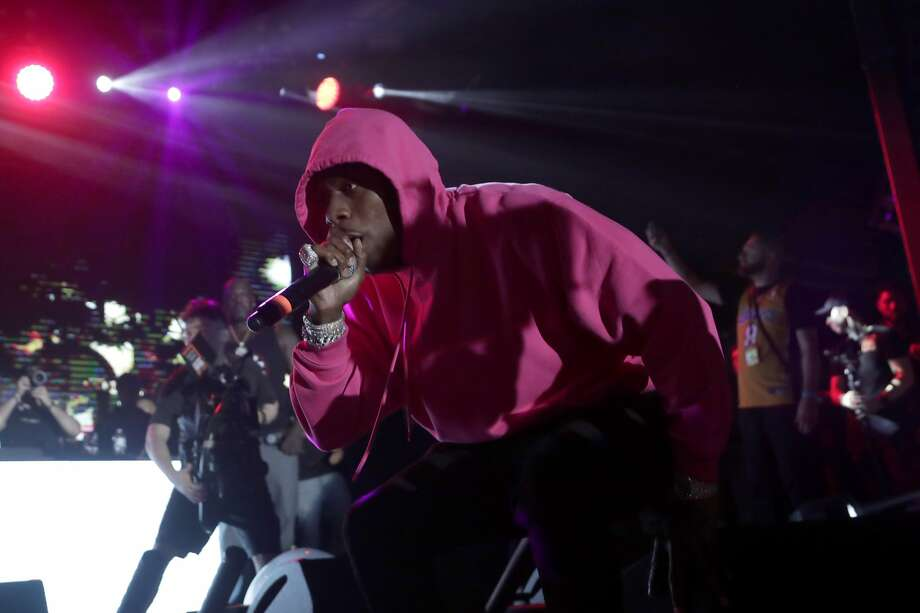 FILE - In this Feb. 1, 2020, file photo, DaBaby performs with NBA basketball player Shaquille O' Neal at Shaq's Fun House in Miami. BET will celebrate its 40th year as a network, as well as it 20th awards show, on Sunday, June 28, 2020, — but the event will go on virtually because of the coronavirus pandemic. The three-hour show will be jam-packed with heavy hitters currently dominating the pop charts and streaming services, including DaBaby, Megan Thee Stallion, Roddy Ricch, Summer Walker, Kane Brown and Chloe x Halle. (AP Photo/Lynne Sladky, File) Photo: Lynne Sladky, Associated Press
