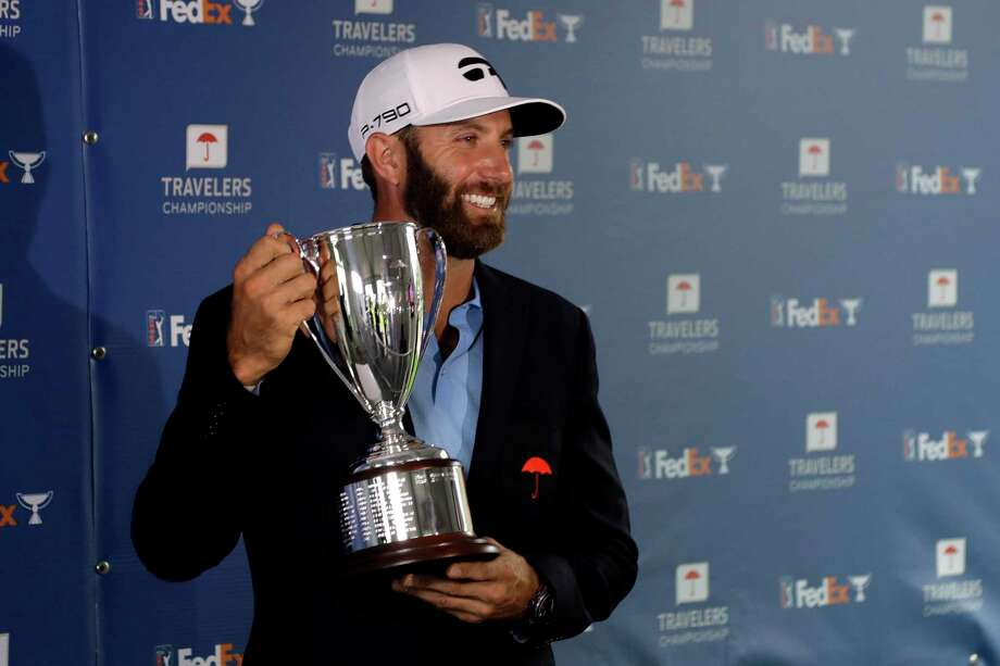 Dustin Johnson poses with the trophy after winning the Travelers Championship Sunday in Cromwell. Photo: Frank Franklin II / Associated Press / Copyright 2020 The Associated Press. All rights reserved