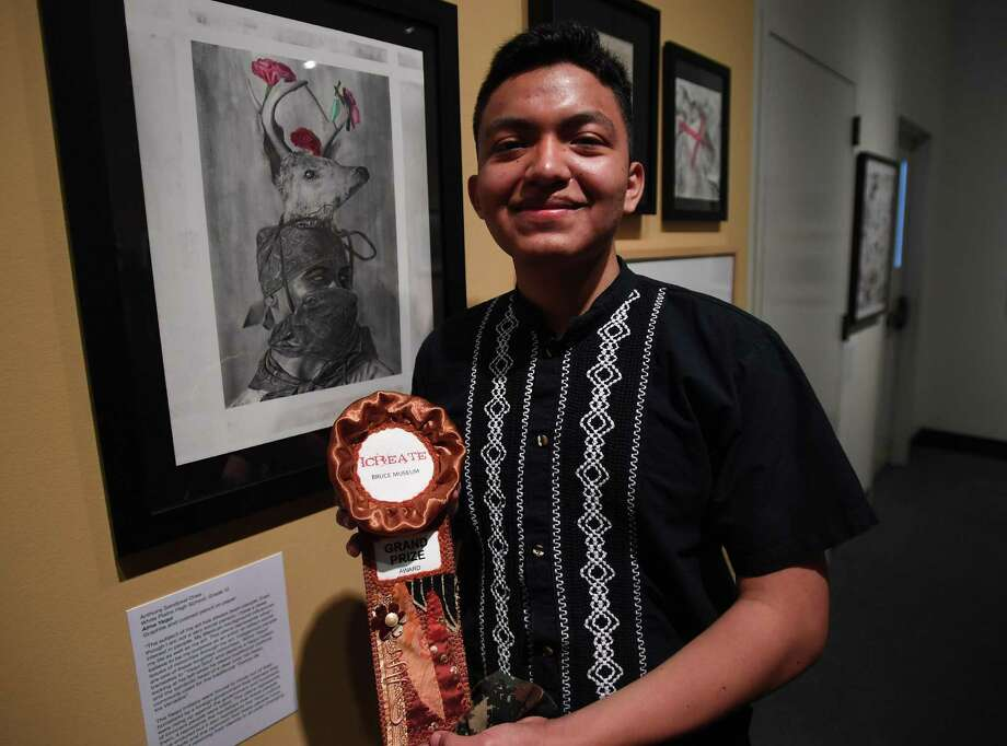 """Mexican immigrant Anthony Sandoval, a 2020 high school graduate from White Plains, NY, won the grand prize in the I Create 2020 juried high school art show at the newly reopened Bruce Museum in Greenwich, Conn. on Sunday, June 28, 2020. Sandoval's drawing """"Alma Yaqui"""" in graphite and colored pencil features a member of the Yaqui tribe from northern Mexico. Photo: Brian A. Pounds / Hearst Connecticut Media / Connecticut Post"""