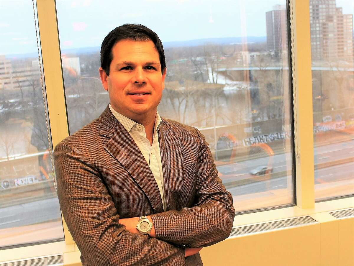 David Lehman, state Commissioner of Economic and Community Development, in his office overlooking the Connecticut River in Hartford.