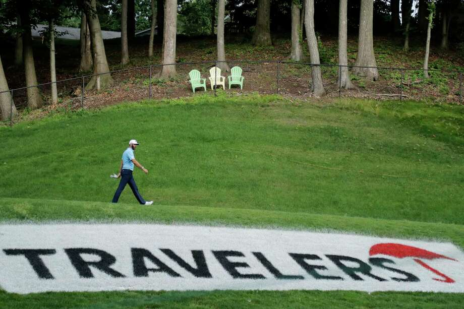 Dustin Johnson walks away from the 15th tee box after teeing off during the final round of the Travelers Championship golf tournament at TPC River Highlands, Sunday, June 28, 2020, in Cromwell, Conn. (AP Photo/Frank Franklin II) Photo: Frank Franklin II / Associated Press / Copyright 2020 The Associated Press. All rights reserved