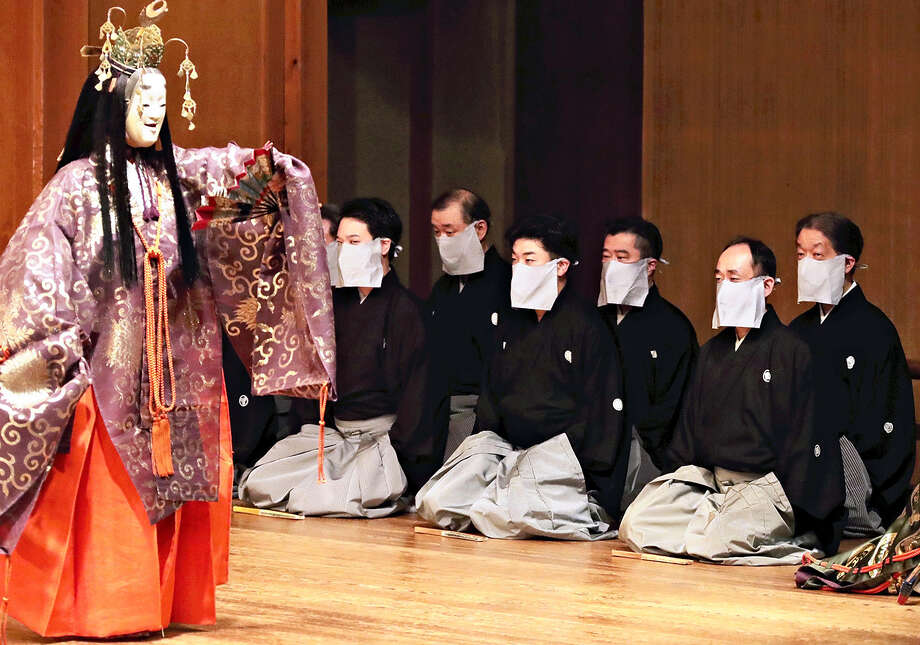 "The Kyoto Kanze Association resumed performing June 28, 2020 at the Kyoto Kanze Noh Theater in Kyoto, Japan, after a self-imposed hiatus due to the spread of the coronavirus. The eight jiutai performers who sing the verses took the stage wearing masks, an unusual move in noh, which values tradition and style. After the performance, association President Kurouemon Katayama said: ""Opinion was divided on wearing masks, even among those of us in the association. However, the safety of our audience took priority."" Photo: Japan News-Yomiuri / Japan News-Yomiuri"