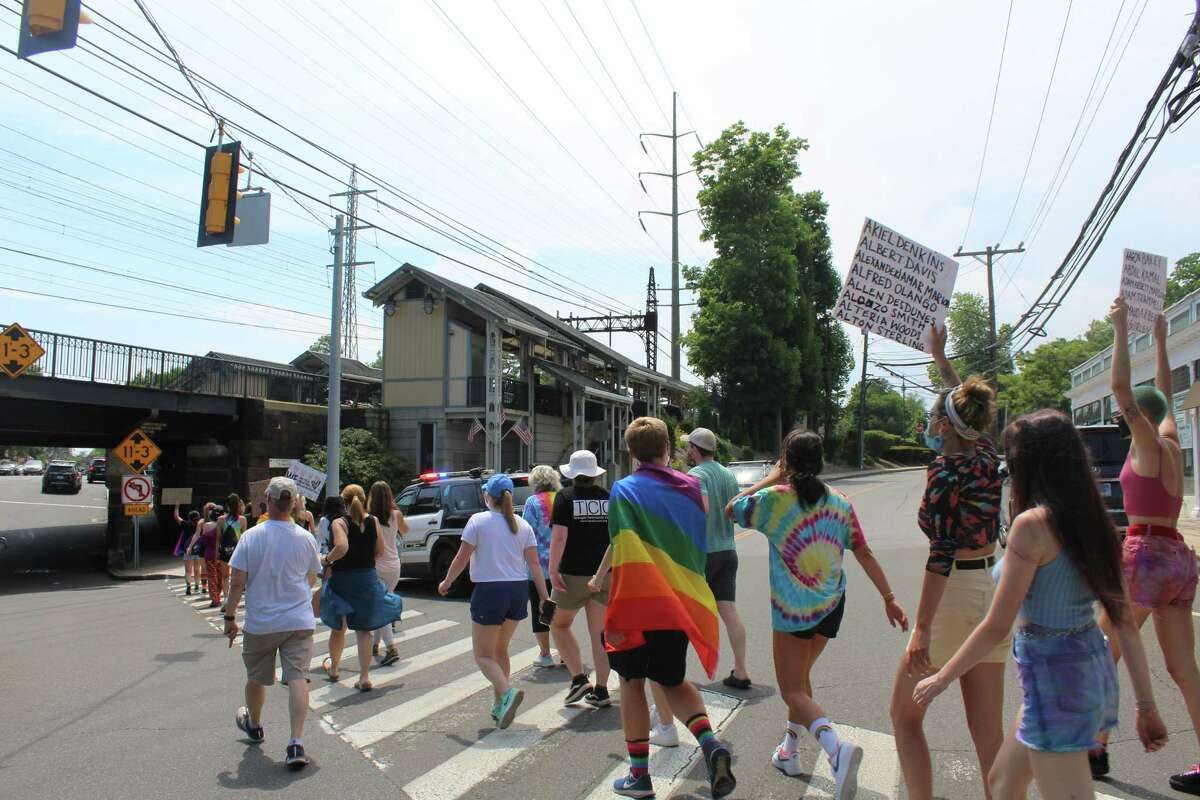 Nearly 100 showed up for a Black Lives Matter and Pride Month protest and open mic on Sunday, June 28.