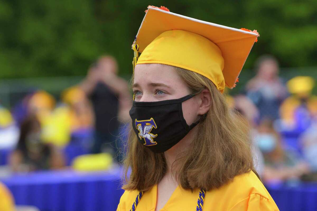 Troy High School graduate Gillian Churan waits her turn to receive her diploma at the first of two graduation ceremonies on the school's football field on Sunday, June 28, 2020, in Troy, N.Y. (Paul Buckowski/Times Union)
