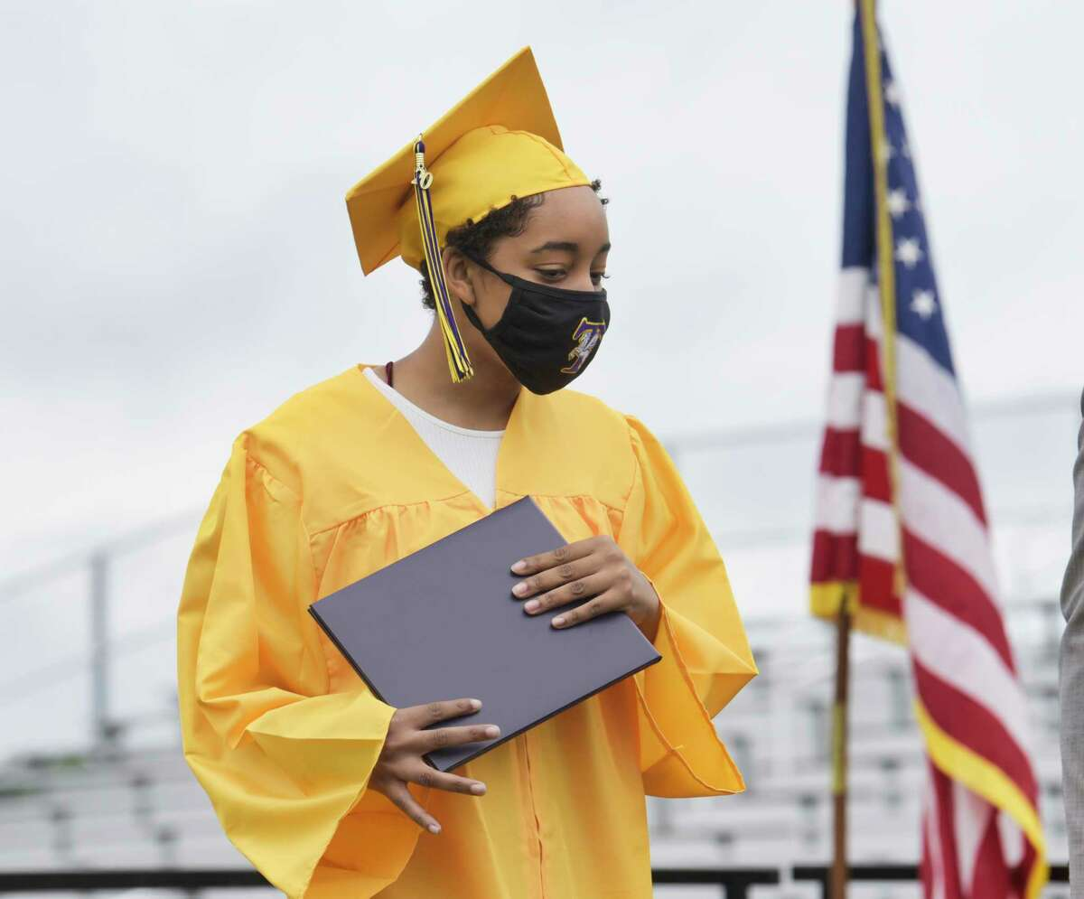 Troy High School graduate Taaliyah Evans walks off the stage after receiving her diploma at the first of two graduation ceremonies on the school's football field on Sunday, June 28, 2020, in Troy, N.Y. (Paul Buckowski/Times Union)