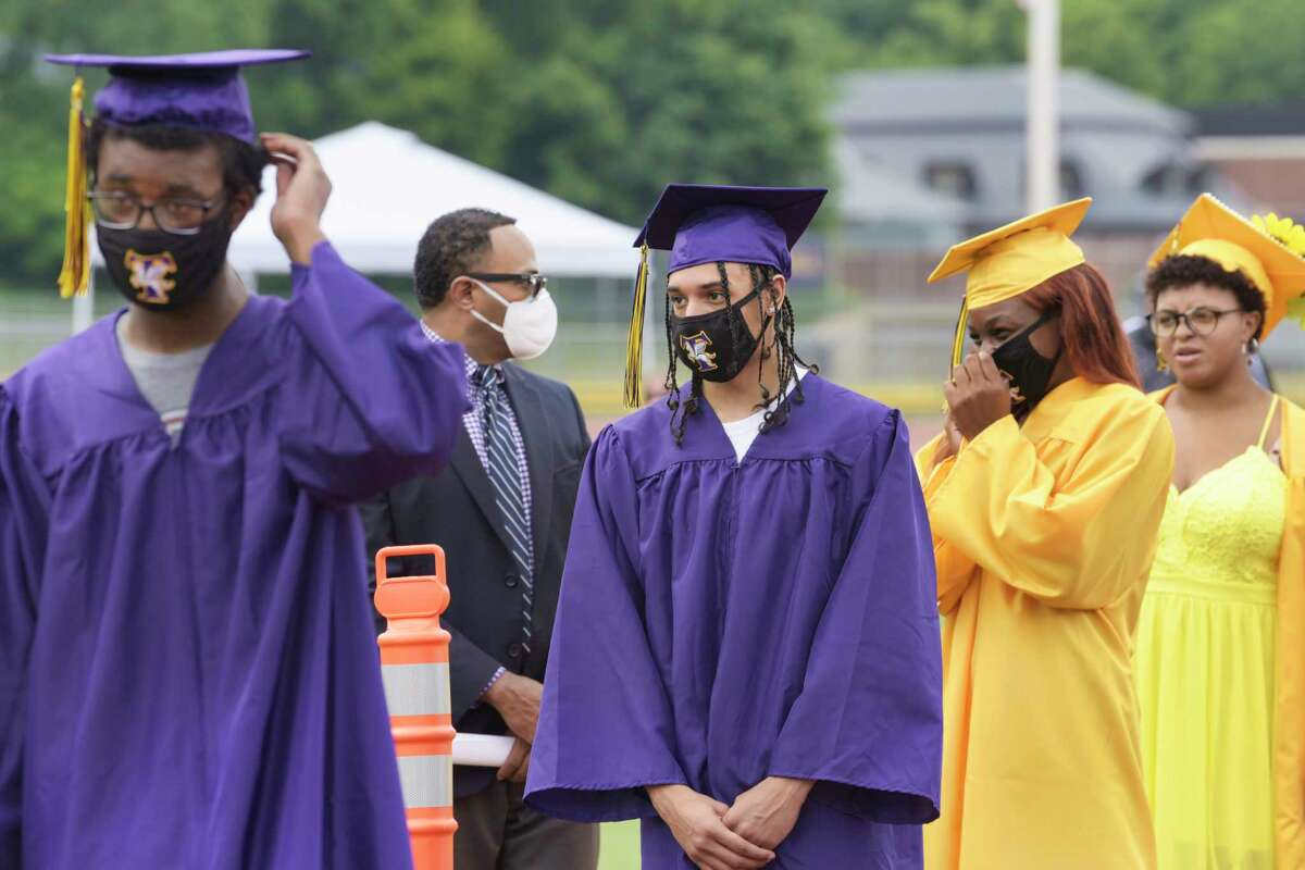 Troy High School graduates line up to receive their diplomas at the first of two graduation ceremonies on the school's football field on Sunday, June 28, 2020, in Troy, N.Y. (Paul Buckowski/Times Union)