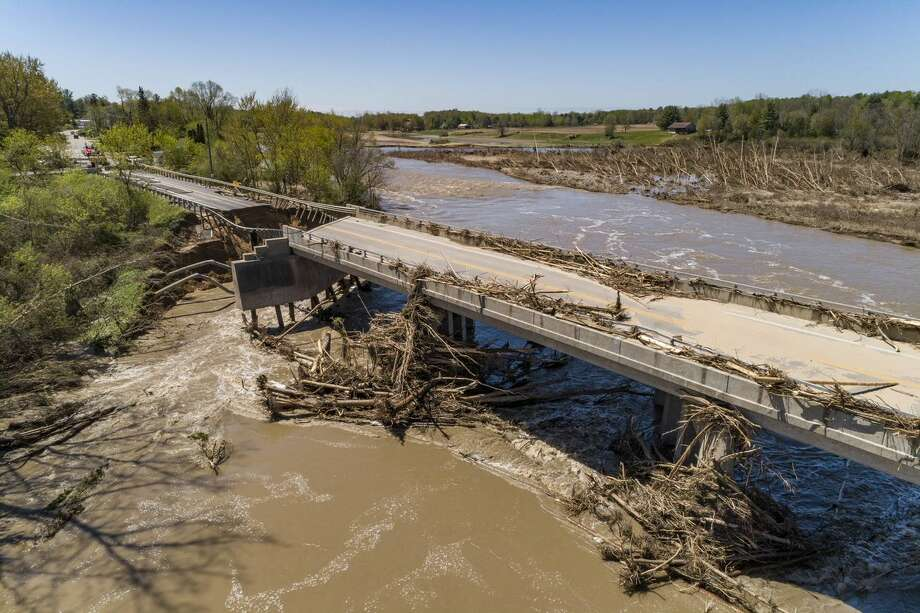 After extensive damage from the flooding in May, a temporary replacement bridge on M-30 over the Tittabawassee River in Edenville is expected to be completed by September. (Photo provided/MDOT) Photo: Photo Provided
