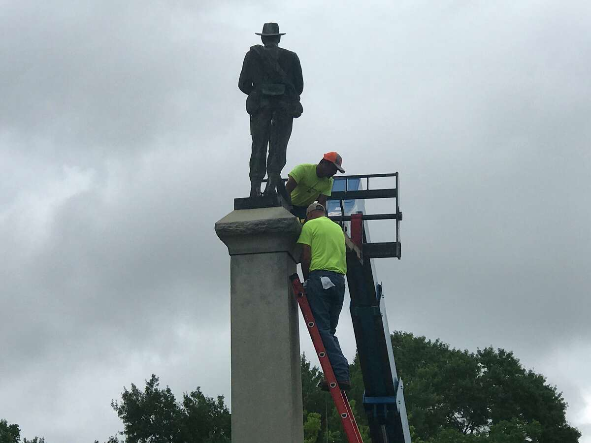 Crew prepping Monday to remove the Confederate statue at Wiess Park in Beaumont. Photo taken June 29, 2020 by Kim Brent/The Enterprise.