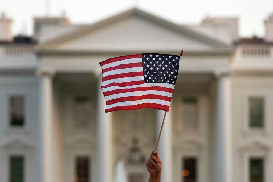 A flag is waved outside the White House, in Washington. Photo: Associated Press / Copyright 2017 The Associated Press. All rights reserved.