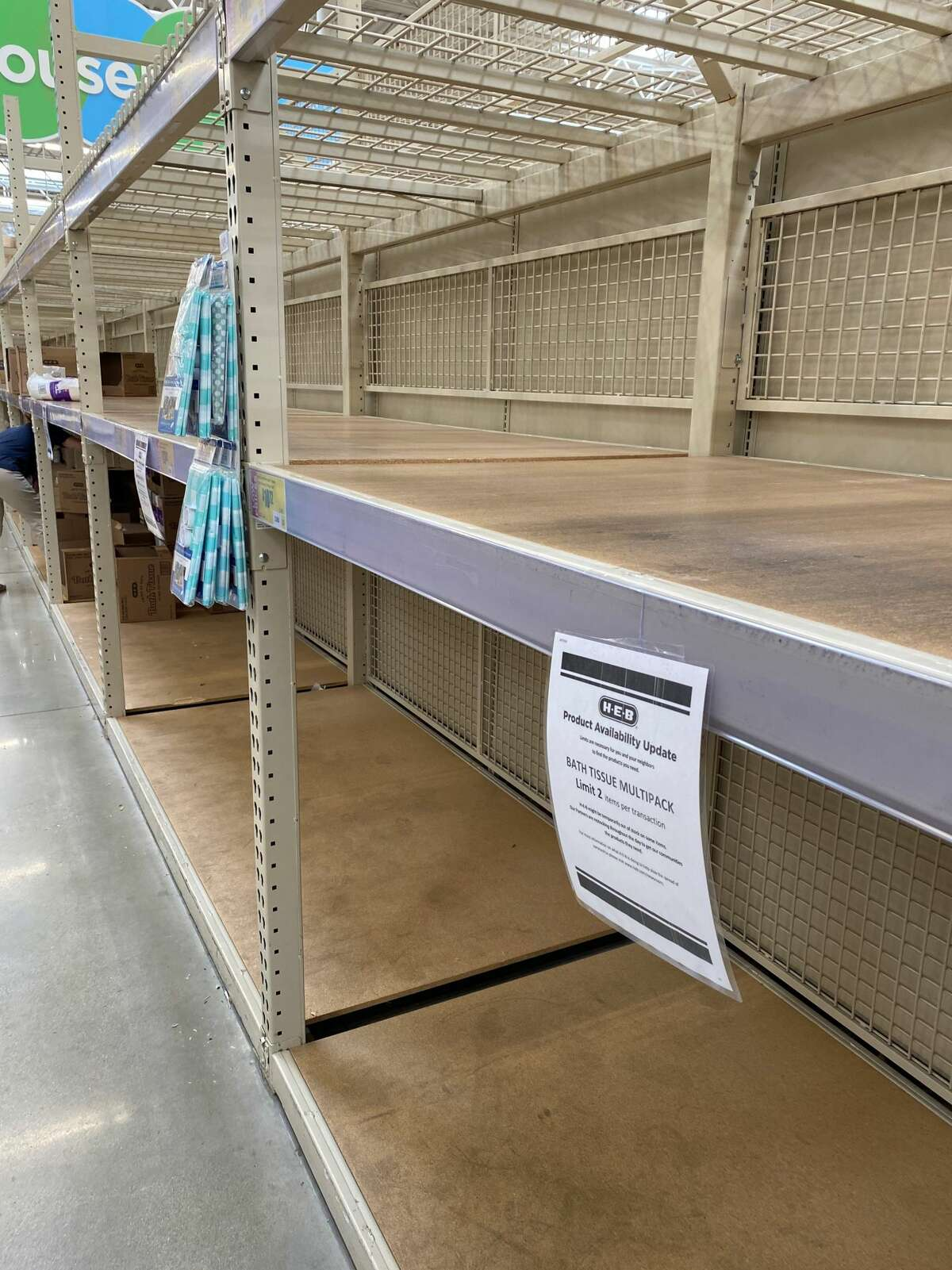 Empty shelves are seen Sunday, June 28, 2020, on the paper product aisle at H-E-B plus! located at 10718 Potranco Rd.