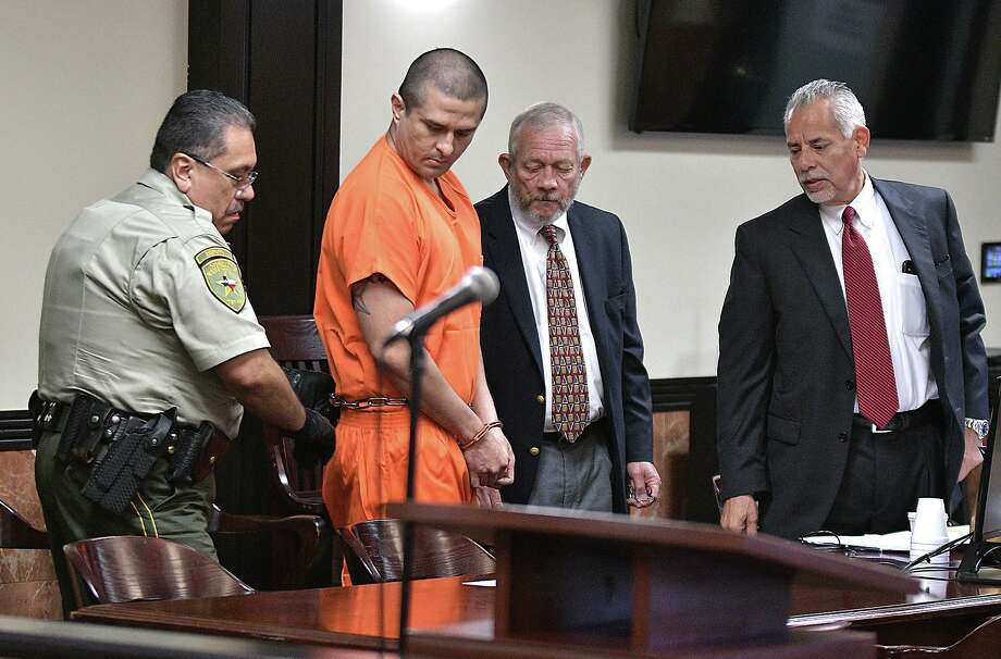 In this file photo, defense attorneys look on as alleged serial killer, former Border Patrol agent Juan David Ortiz, is escorted in the 406th District Courtroom at the Webb County Justice Center on Oct. 3, 2019. Ortiz is charged with capital murder of multiple persons, aggravated assault with a deadly weapon, unlawful restrain to substantial risk of injury and evading arrest. Photo: Cuate Santos /Laredo Morning Times File / Laredo Morning Times