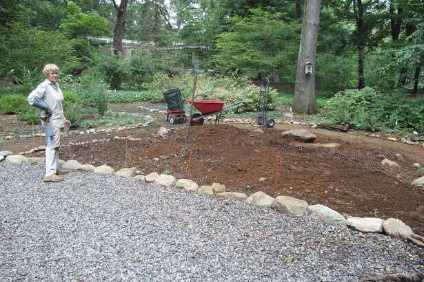 By digging and digging some more, Cos Cob resident Beverly Smith turned a sun-deprived backyard into a shade-lover's sanctuary.