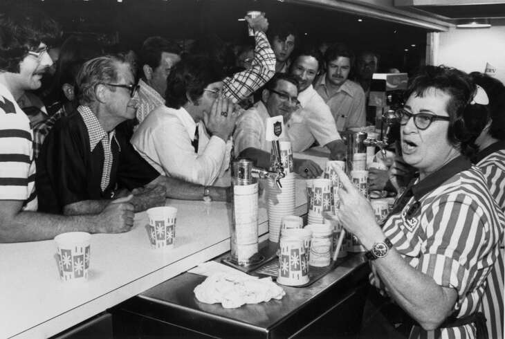 """Fans rush the Astrodome beer vendors during a 1974 """"Foamer Night,"""" in which fans are treated to free beer if an Astros player bashes a home run when the foamer light is illuminated."""