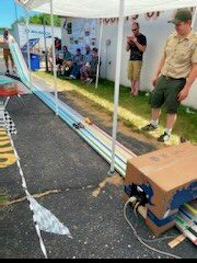 Scouts from BSA Troop 74 in Reed City competed for trophies at the Pinewood Derby on Sunday. The Pinewood Derby is an annual event where scouts race against each other with cars made from a block of wood, some wheels and paint. Trophies were awarded for first through third place finishes and for Best in Show. (Submitted photo)
