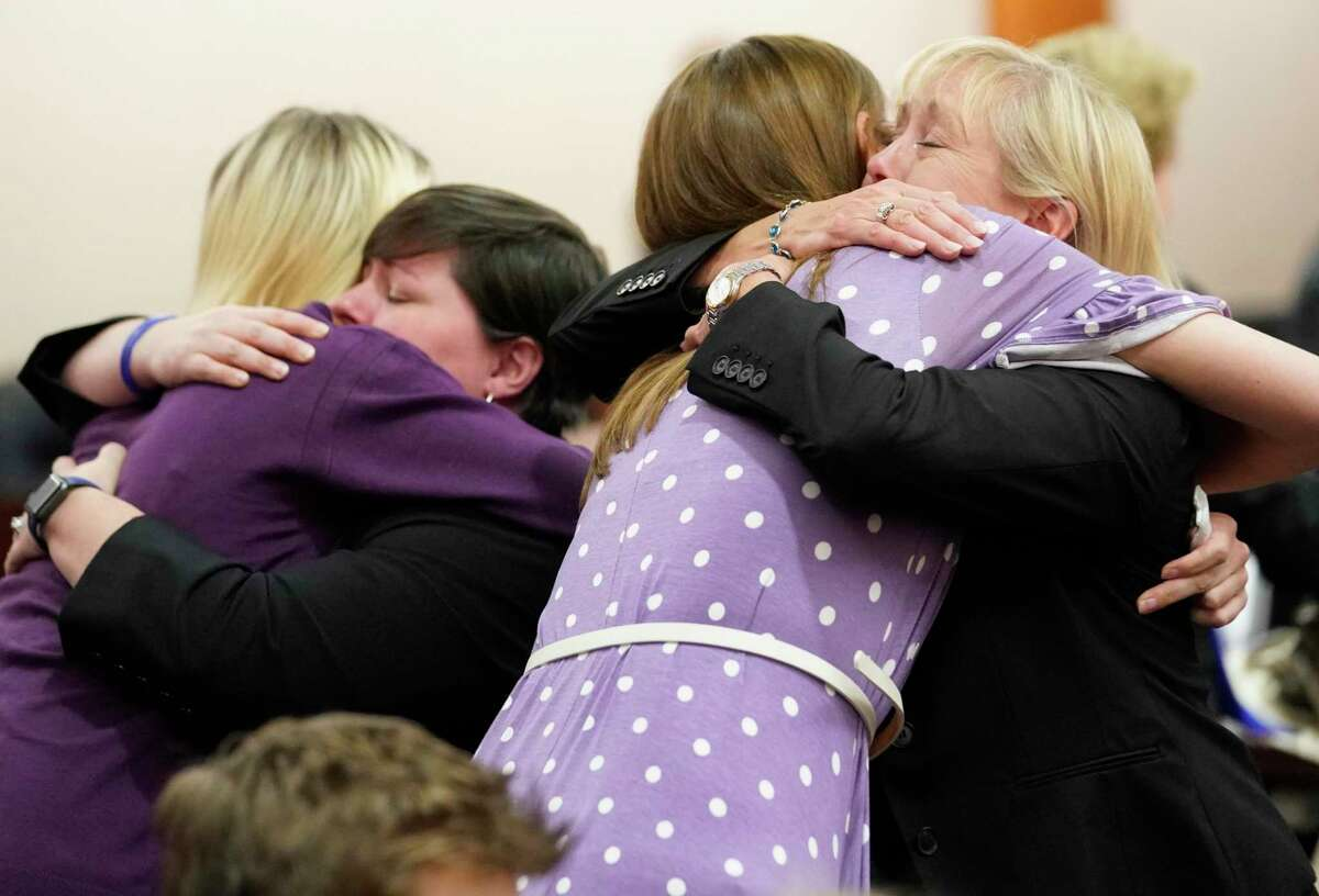 Cassidy Stay, left, hugs Lauren Bard, prosecutor, and Melannie Lyon hugs Kaylynn Williford, prosecutor, right, as family members react after the sentence of death for Ronald Lee Haskell Thursday, Oct. 11, 2019 in Houston. Haskell was convicted of capital murder in the 2014 massacre that killed six of members of Cassidy Stay's family in Spring. Melannie Lyon is the ex-wife of Ronald Lee Haskell and the sister of Cassidy Stay's mother.
