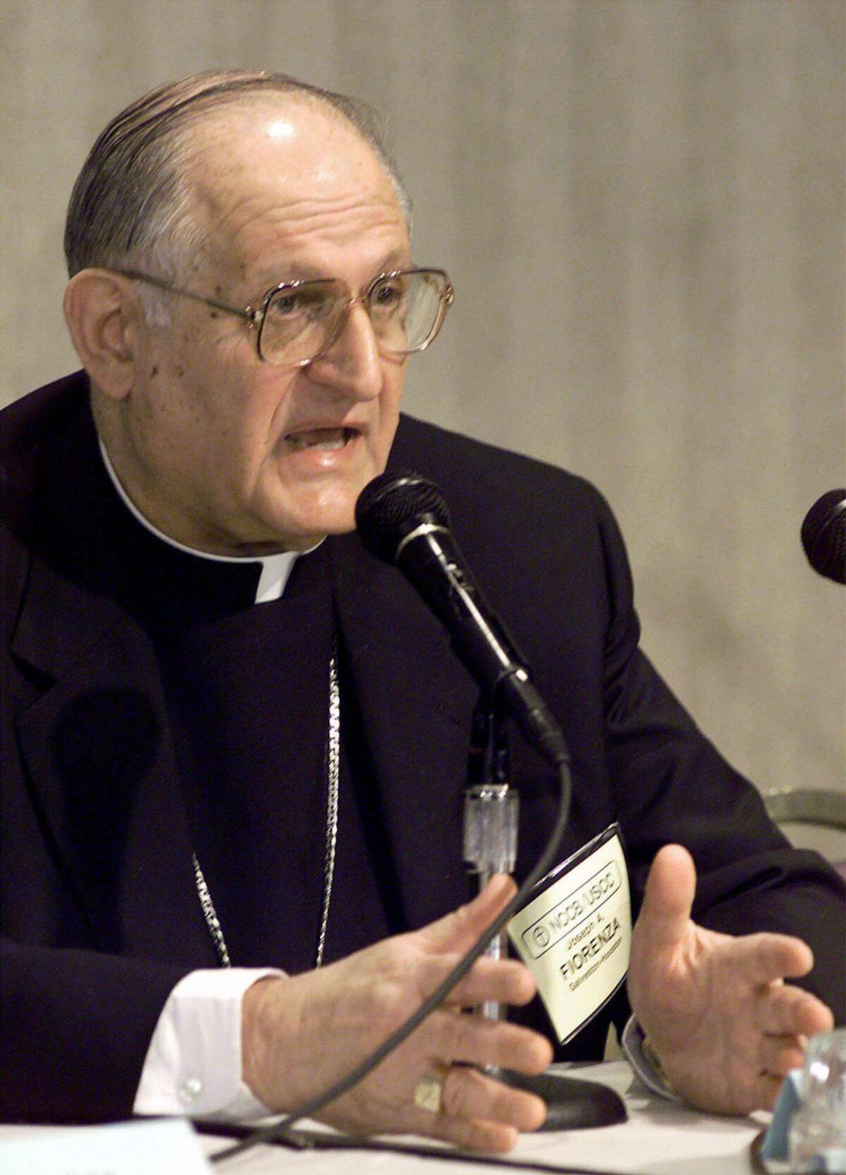 Archbishop Joseph Fiorenza, shown in this November 1999 file photo when he served as president of the National Conference of Catholic Bishops, is one of four priests with the Archdiocese of Galveston-Houston who have tested positive for COVID-19.