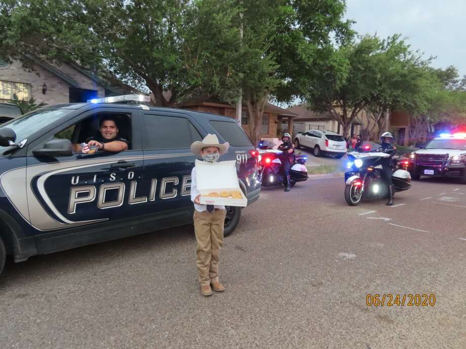 "Laredoan Christian Guajardo celebrated his eighth birthday with a ""Back the Blue"" themed parade showing support for local law enforcement and handing out doughnuts to officers. Photo: Courtesy Photo"