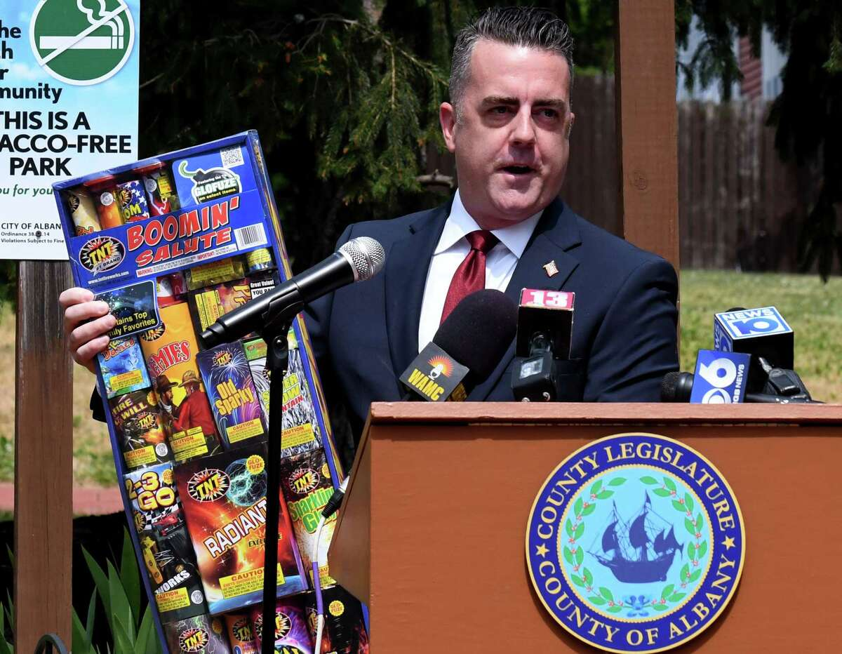 Albany County Legislature Chairman Andrew Joyce holds a box of locally purchased sparkler-type fireworks during a press conference where county leaders addressed concerns over an increasing use of illegal fireworks on Monday, June 29, 2020, at Hudson-Jay Park in Albany, N.Y. Chairman Joyce said the county's fireworks rules will be changed because he says it?•s impossible for law enforcement to discern between legal & not legal fireworks. (Will Waldron/Times Union)