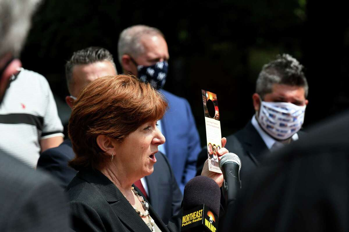 Albany Mayor Kathy Sheehan holds a fireworks awareness door card which is being distributed in the hope of halting use of illegal fireworks on Monday, June 29, 2020, during a press conference at Hudson-Jay Park in Albany, N.Y. County Legislature Chairman Andrew Joyce said the county's fireworks rules will be changed because he says it?•s impossible for law enforcement to discern between legal & not legal fireworks. (Will Waldron/Times Union)
