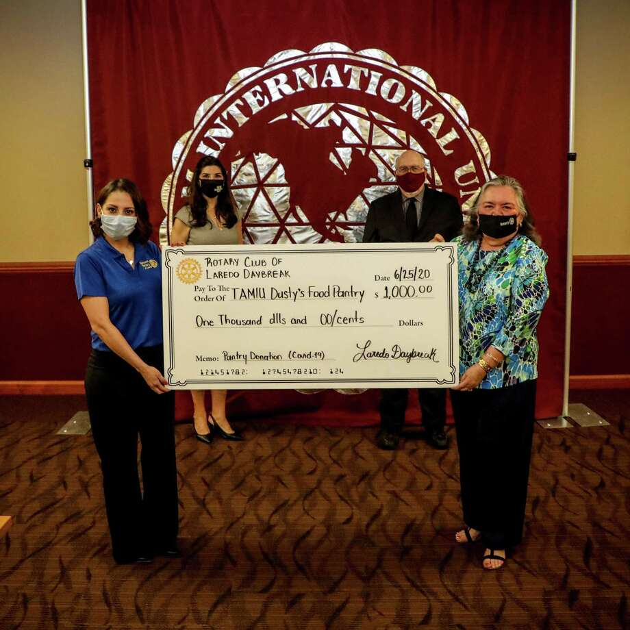 Laredo Daybreak Rotary Club is supporting TAMIU's Dusty's Pantry for students with a generous member donation. Pictured in the front at a check presentation are Daybreak Rotary president Liz Gomez and assistant district governor Lupita Zepeda, and in the back are TAMIU vice president for Student Success Dr. Minita Ramirez and TAMIU president Pablo Arenaz. Photo: Courtesy Photo