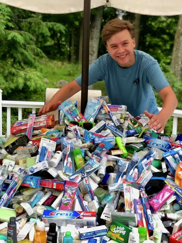 Lukas Dapkus, a rising senior at Ridgefield High School organized a toiletrydrive on Saturday, June 27 at St. Mary School to benefit the Dorothy Day Hospitality House in Danbury. Ridgefield residents donated nearly 400 pounds of toiletrysupplies, including soap, shampoo, razors and toothpaste. The collected supplies will be donated to the Dorothy Day Hospitality House. Photo: Contributed Photo