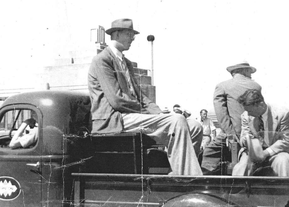Robert Wadlow sits in the back of a pickup truck during the fifth Forest Festival Grand Parade on July 4, 1940. Wadlow, the World's Tallest Man, was brought in as an attraction for that year's festival and would pass away in Manistee 11 days later.