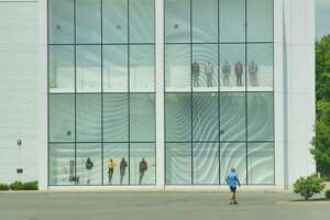 A man walks through the parking lot past a closed Lord and Taylor store at Crossgates mall on Monday, June 29, 2020, in Colonie, N.Y.  (Paul Buckowski/Times Union)