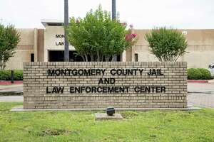 A brick sign stands outside of the Montgomery County Jail in Conroe, Thursday, June 25, 2020.