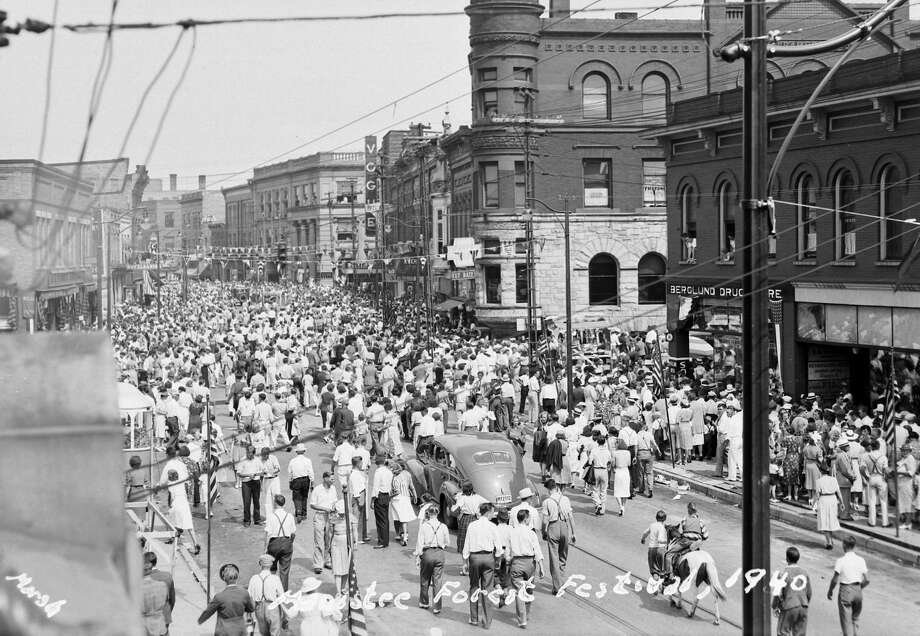A crowd estimated at 40,000 to 50,000 was in attendance at the 1940 Manistee National Forest Festival. Pictured is a view of the parade looking east down River Street. Photo: Manistee County Historical Museum/Courtesy Photo