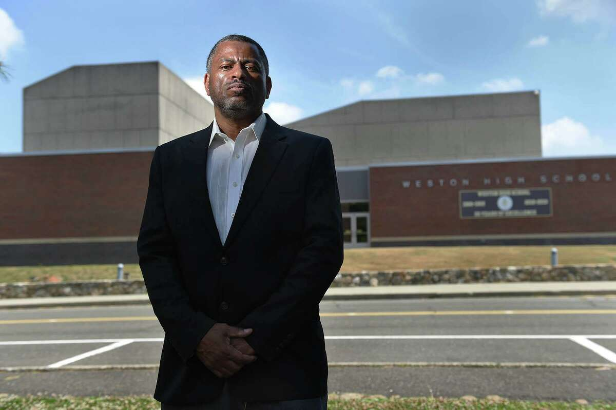 Brian Murray-Dalrymple moved his family to Weston eight years ago for the excellent school system for his five children. He is pictured in front of the high school where he says his children were the targets of racism and discrimination over the years, June 23, 2020.