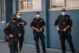Police officers monitoring protesters in San Francisco on Friday, May 22, 2020.