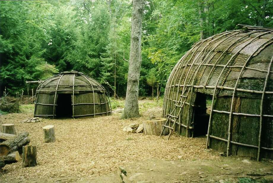 """The Institute for American Indian Studies in Washington, Conn., invites you to its redeveloped Outside Museum, where you can enjoy newly created safe and educational learning experiences Fridays through Sundays. This includes visiting the rebuilt 16th-century replica Algonkian Village, perfect for exploring how Native Americans lived and thrived prior to European contact. There's also a new """"UnNature Trail,"""" which includes items that do not belong, creating a unique way to increase your ability to observe nature. You'll learn about food sustainability and natural healing methods in the traditional Three Sisters and Medicinal Plant Gardens, and enjoy games and educational scavenger hunts along the Institute's woodland trails. Wigwam Escape (a unique puzzle room) has reopened, too, along with the indoor museum, which features authentic artifacts, a new exhibit, """"Skug: Snakes of New England,"""" and an Indian longhouse. (Skug means snake in Algonkian.) To ensure proper cleaning and allow for the setup of educational activities, hours are Fridays and Saturdays, 11 a.m. to 4 p.m., and Sundays, noon to 4 p.m. All staff who interact with visitors wear masks. Visitors are encouraged to wear them, as well. Click here for the latest details.  Photo: Contributed Photo"""