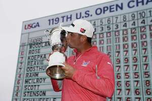 FILE - In this June 16, 2019, file photo, Gary Woodland poses with the trophy after winning the U.S. Open golf tournament in Pebble Beach, Calif. The U.S. Open is returning to NBC starting with this year's tournament.