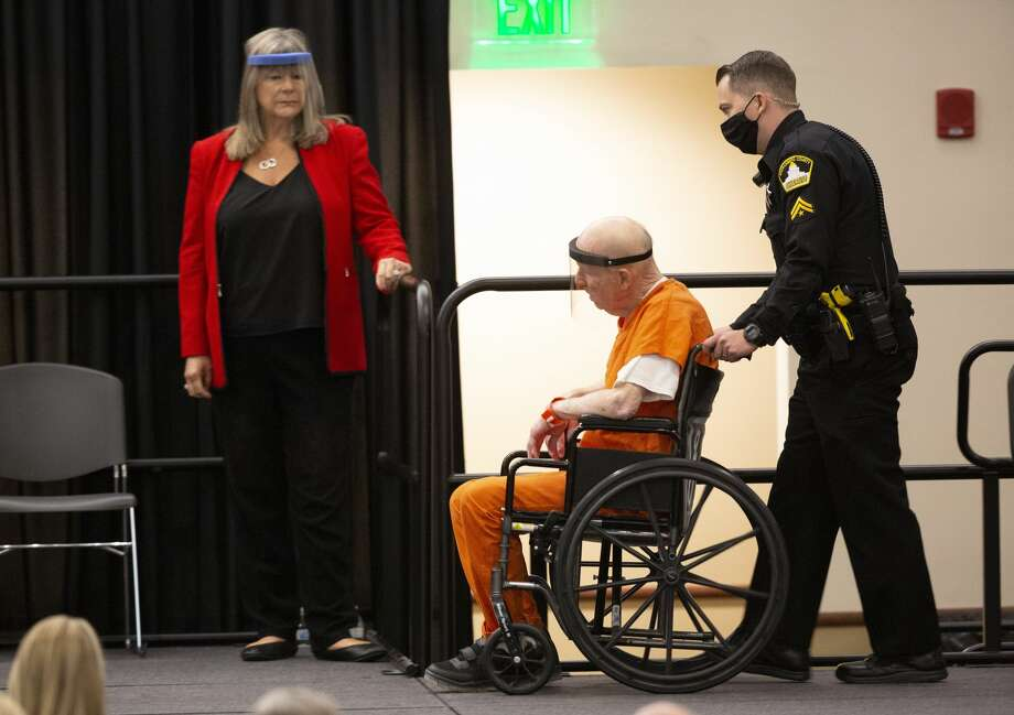 Joseph James DeAngelo, charged with being the Golden State Killer, is wheeled into the courtroom as his attorney, public defender Diane Howard, left, looks on in Sacramento, Calif., Monday June 29, 2020. DeAngelo, 74, pleaded guilty to multiple counts of murder and other charges 40 years after a sadistic series of assaults and slayings in California. Due to the large numbers of people attending, the hearing was held at a ballroom at California State University, Sacramento to allow for social distancing. (AP Photo/Rich Pedroncelli) Photo: Rich Pedroncelli/Associated Press / Copyright 2020 The Associated Press. All rights reserved