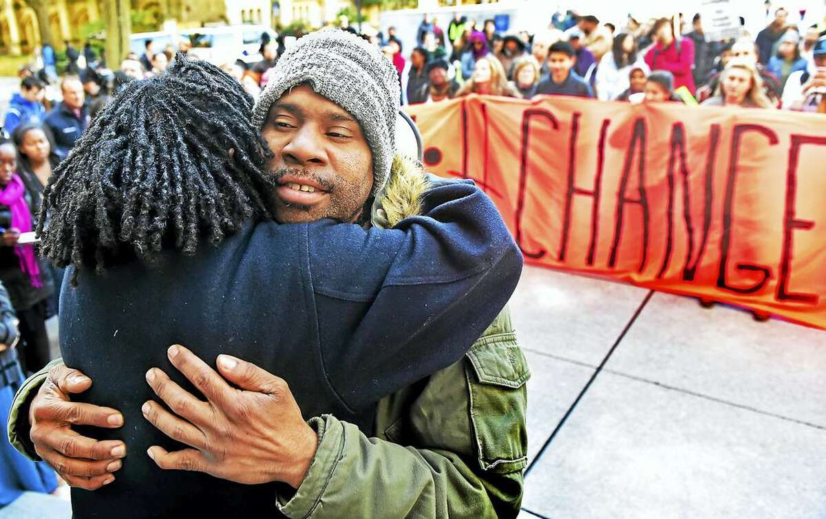 Corey Menafee, a Yale employee, hugs Kica Matos , director of Immigrant Rights and Racial Justice atthe Center for Community Change, during a rally in a coalition of city groups and the Yale University community in Beinecke Plaza in front of Woodbridge Hall in New Haven, protesting the name of Yale's Calhoun College and calling for its renaming. It was renamed Grace Hopper College.