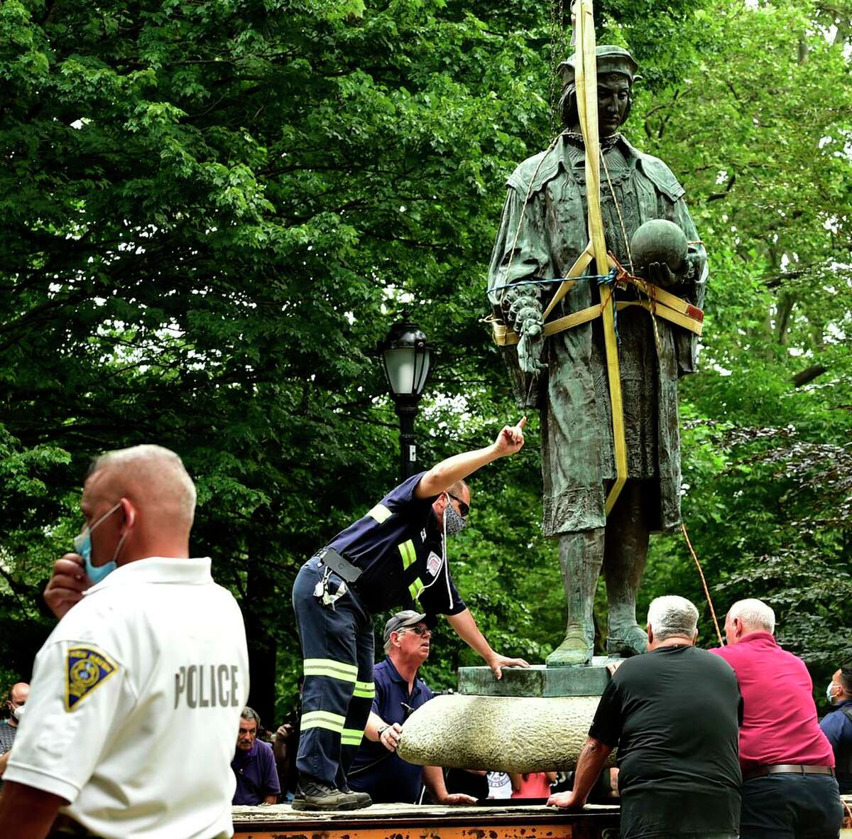 The statue of Christopher Columbus was removed from Wooster Square park June 24, 2020 after a skirmish erupted early in the morning between people of opposing viewpoints. Later, with a large police presence, hundreds of people gathered to watch the removal of the monument and demonstrate against racism.