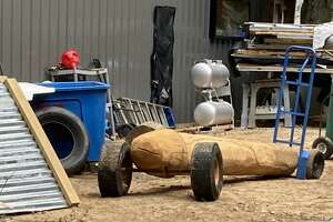 Jamie Gagne's penis sculpture lays along his side of his unfinished workshop.