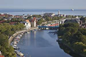 Germany, Rostock, View of harbour with Warnow River - stock photo