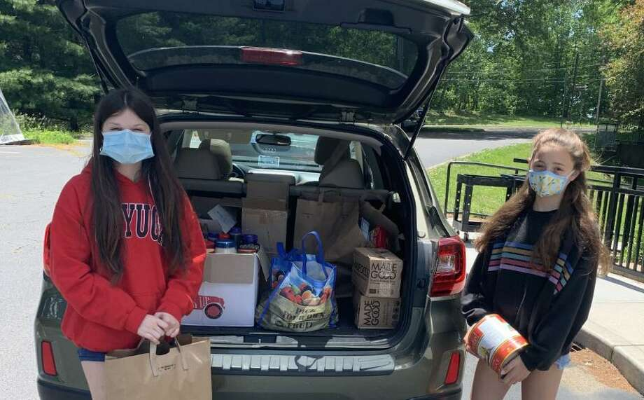 Wilton's Chloe Thompson, left, and Abby Jones, both students at Our Lady of Fatima Catholic Academy, deliver their food drive donations to the Wilton Food Pantry. June 2020 Photo: Contributed Photo / Our Lady Of Fatima Academy / Wilton Bulletin Contributed