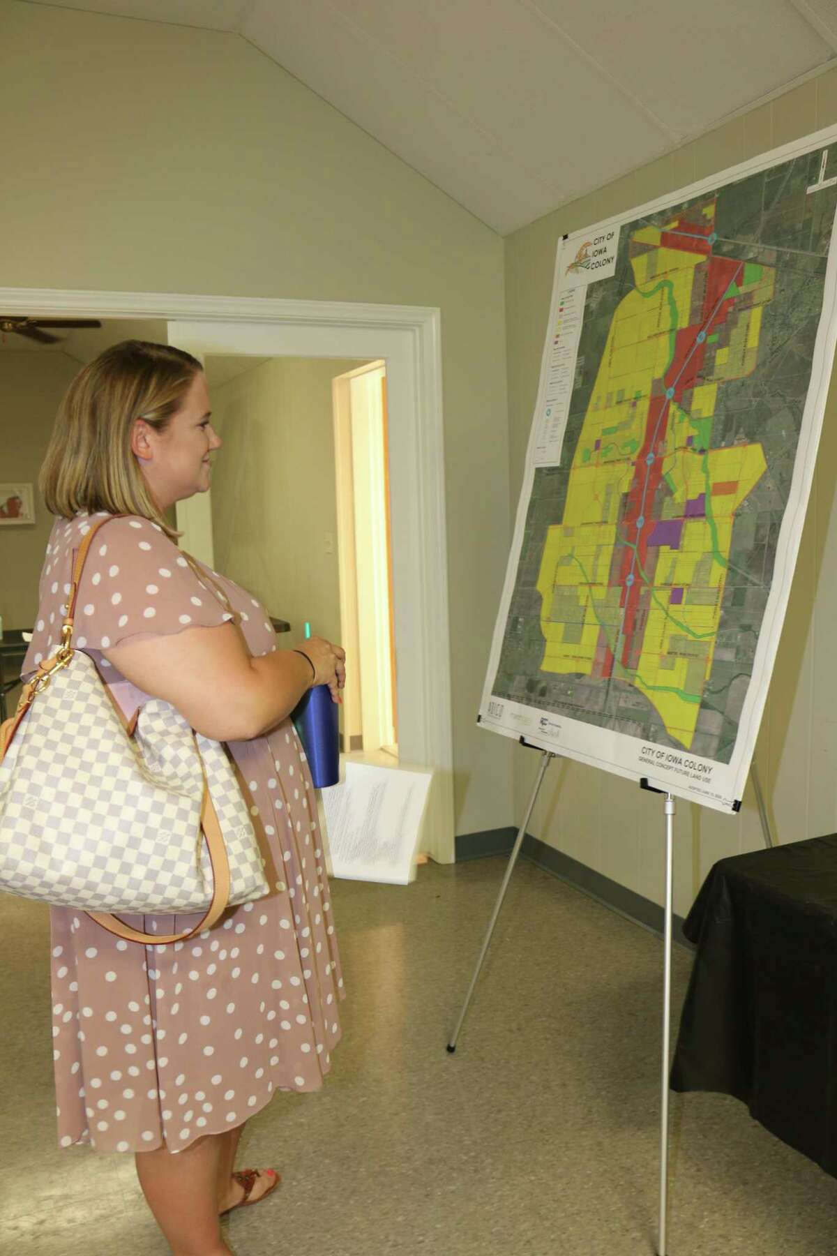 Sydney Hargroder checks out a map of what Iowa Colony's future land could look like.