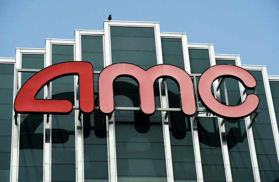 FILE - In this April 29, 2020 file photo, the AMC sign appears at AMC Burbank 16 movie theater complex in Burbank, Calif. AMC Theaters, the nation's largest chain, is pushing back its plans to begin reopening theaters by two weeks. The company said Monday that it would open approximately 450 U.S. locations on July 30 and the remaining 150 the following week. (AP Photo/Chris Pizzello, File) Photo: Chris Pizzello, INVL / Associated Press / 2020 Invision