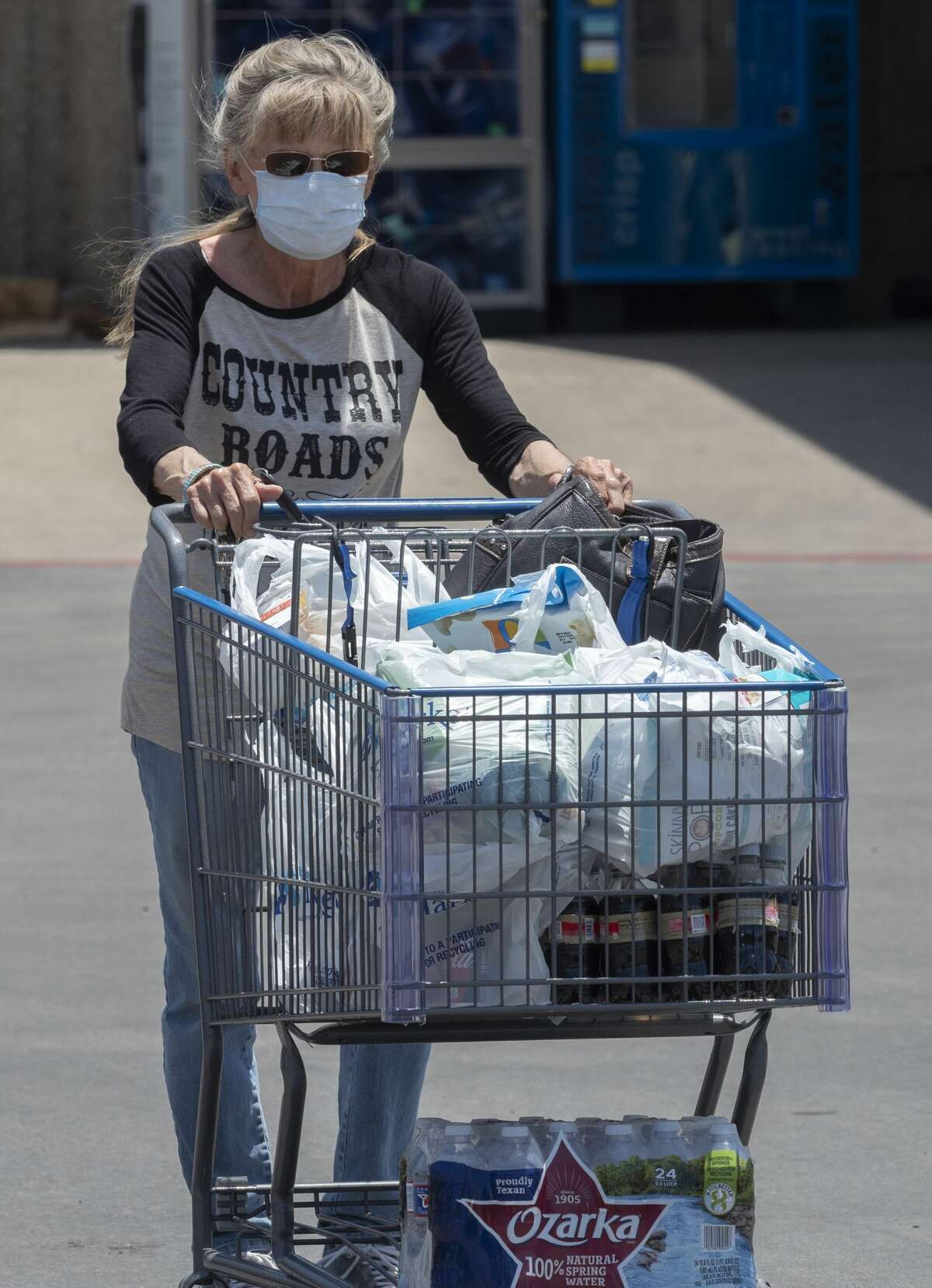 Nancy Anderson and other shoppers wear their masks as they leave the grocery 06/29/2020 outside United on Andrews Hwy. Tim Fischer/Reporter-Telegram